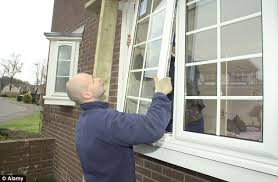 man fixing window